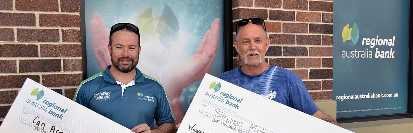 Regional Australia Bank New England Manager, Dane O'Conner stands with the winner of our Member Survey, Stephen Matthews holding a $1000 cheque for Can Assist Armidale while Stephen holds his $1000 cheque prize money.